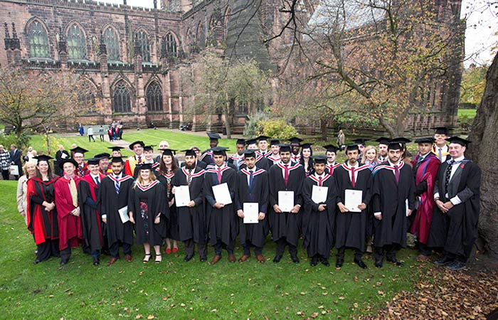 Pictured just after their graduation ceremony, are some of the Faculty of Science and Engineering's first full cohort of degree graduates, and their lecturers.