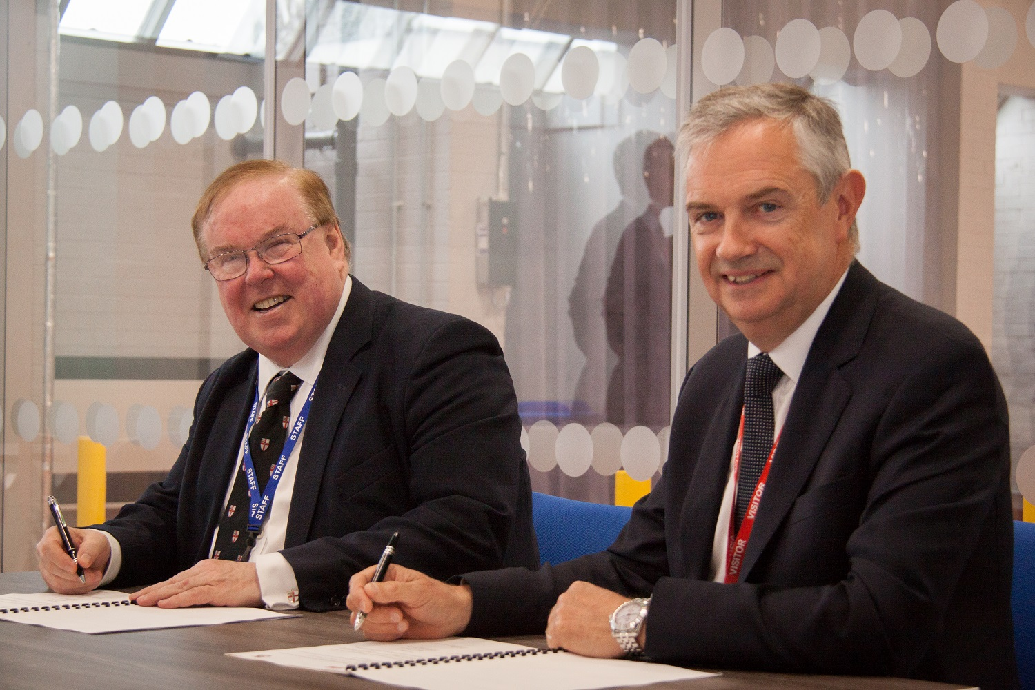 Professor Tim Wheeler, Vice Chancellor at the University of Chester (left) with Ian Funnell, Managing Director, ABB in the UK, signing the agreement.