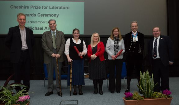 Pictured, left to right, are Dr Ian Seed; Dr Michael Arditti; Cathy Bryant; Lynne Parry-Griffiths; Pauline Brown; High Sheriff of Cheshire, Mr Bill Holroyd; and Vice-Chancellor of the University of Chester, Professor Tim Wheeler.