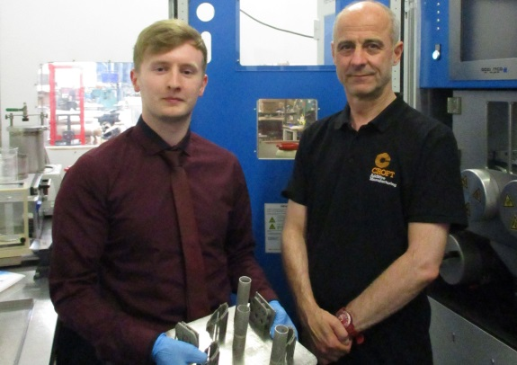 •	University of Chester student, Christian Mamwell, on the left, holds some of the product manufactured as part of his project. Rob Watkins from Croft Additive Manufacturing supervises.