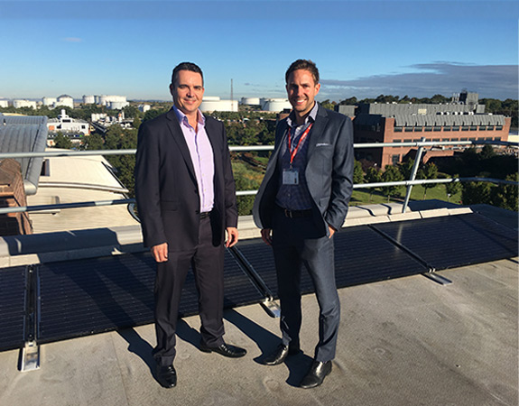 Paul Vernon from the University of Chester and Craig Jones from Energy Gain UK on the Energy Centre roof.