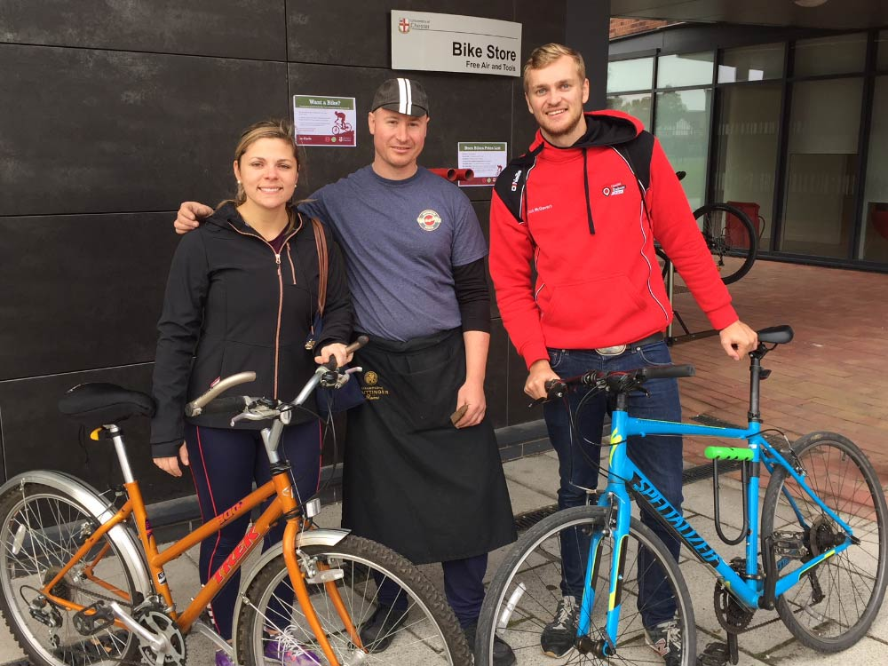 International student Pia Gutierrez with her reconditioned bike; Mariusz Goralski from Bren Bikes; Jack McGovern, Chester Students' Union Vice-President (Activities).