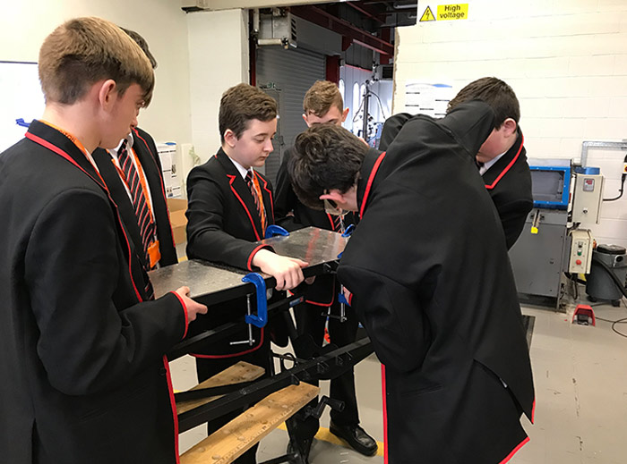 From left to right, students Ben Walters, Jamie Cavanagh, William Nuttall, Liam Terry, Ben Jones (with his back facing the camera), and Albie Rossiter.