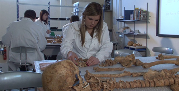 Students analysing record human skeletal remains from a Medieval cemetery in Chester.