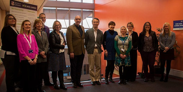 Yasumasa Shinohara, from the Japanese Ministry of Education (centre,) pictured with staff at the University of Chester, including Jeremy Peach, Director of Work Based Learning (to Yasumasa's right) and, standing next to Jeremy, Dr Wendy Dossett.