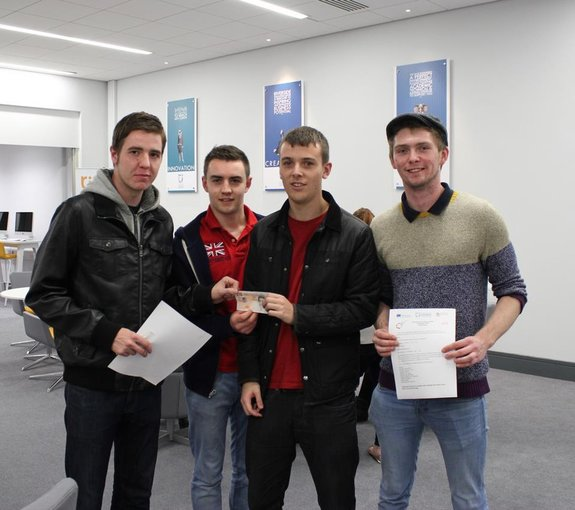 Team 'Four' – Students James Hankin, Daniel Sankey, Jack Bladon and Matthew Boxer receiving their £10 investment.